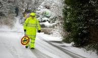 THOMOND. GREENMOUNT, 21st January 2013 - School crossing patrol officer Tony Vickers working in the snow at Greenmount, Bury.